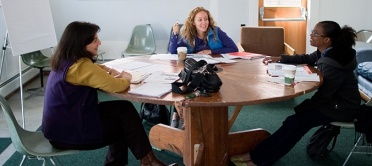 SIS Founder Sarah Bobrow-Williams and students
