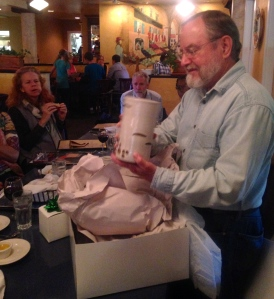 Ralph opening a gift from the faculty, a ceramic wine cooler